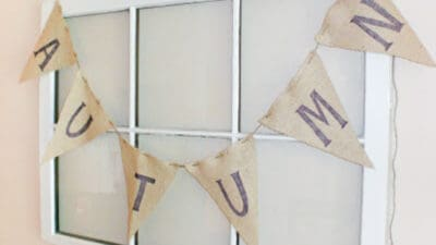 burlap banner spelling autumn hanging on window