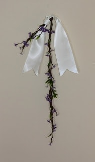 A piece of lavender tied with a bow.