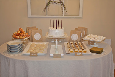 A cake and various sweet treats with a brown and gold theme.