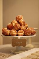 Mini doughnut holes on a cake stand.