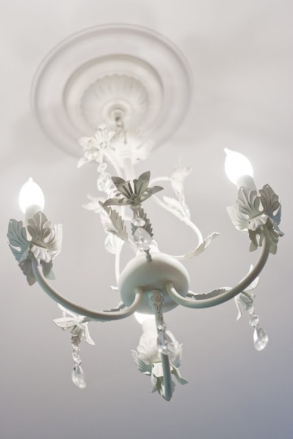 A white, floral chandelier.