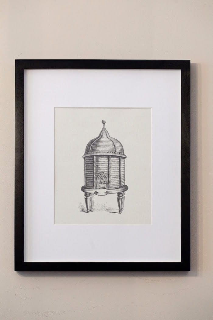 Beehive print in black frame with wide white mat.