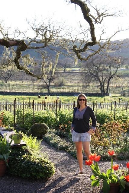 Julie posing in front of the vineyard.