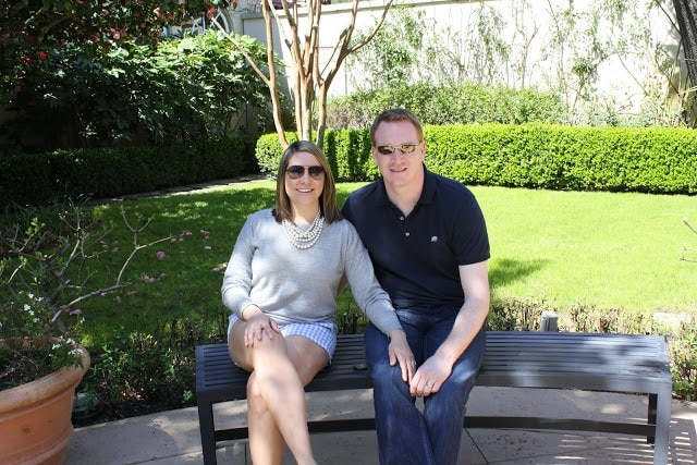 Julie and her husband sitting on a bench.