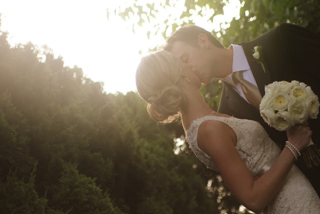The bride and groom kissing.