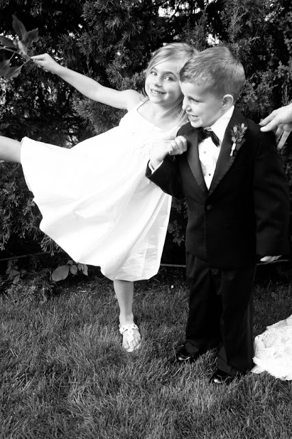 The flower girl and the ring bearer playing together.