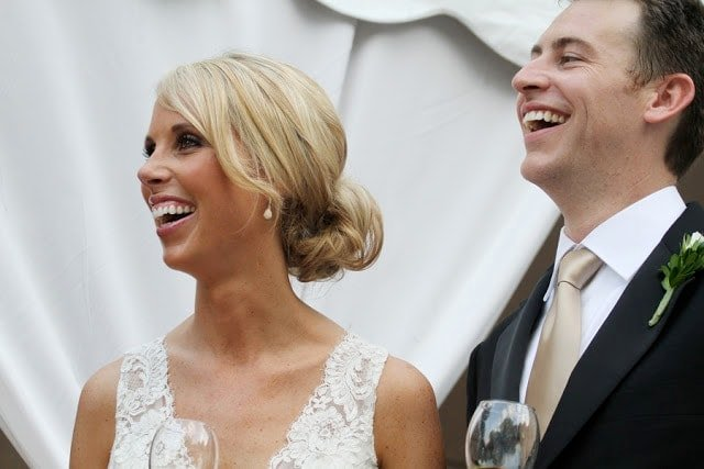 The bride and groom laughing together