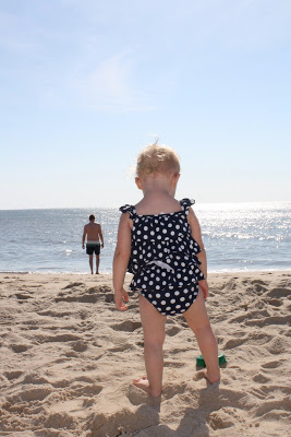A little girl standing on a beach