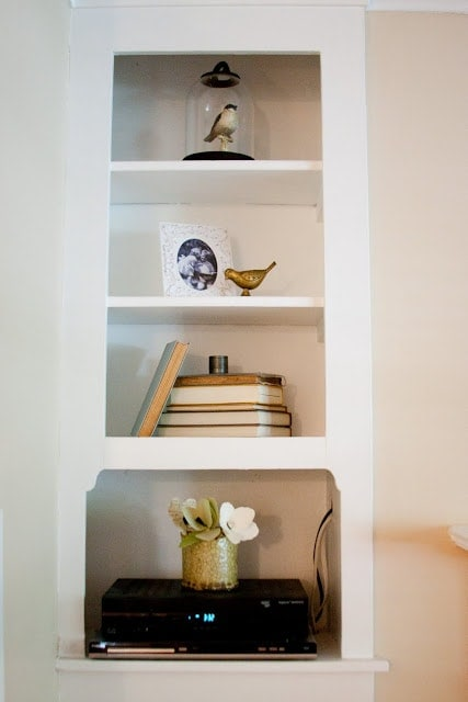 White shelves with various decoration in the inside of a home.