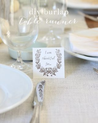 A set table with a burlap table runner.