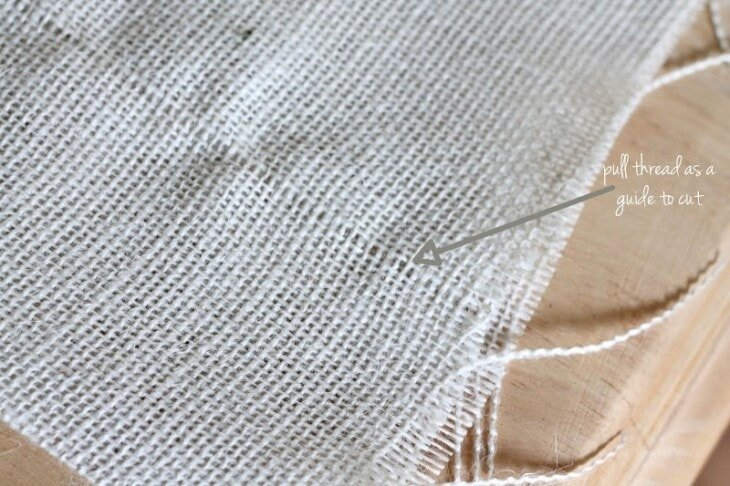 pull one thread from burlap to create a straight line