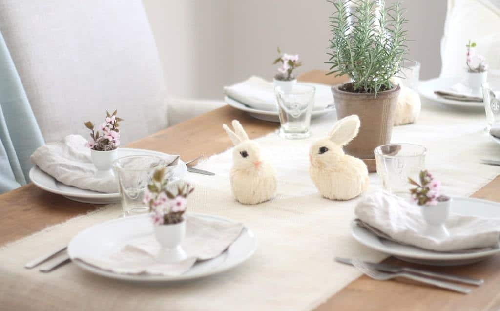 An Easter table setting with a jute burlap runner