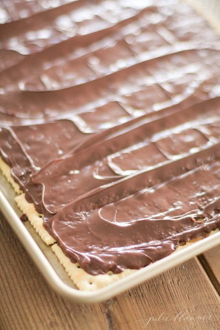 Melted chocolate on top of the crackers