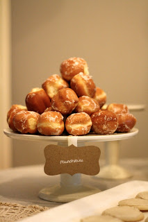 Doughnut holes on a ceramic cake stand.