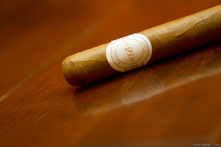 A cigar on a wooden surface.