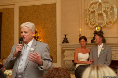 The father of the bride giving a speech at the wedding.