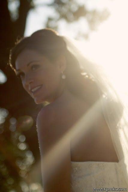 A bride smiling back at the camera.