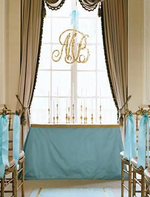 A hanging monogram sign at a wedding.
