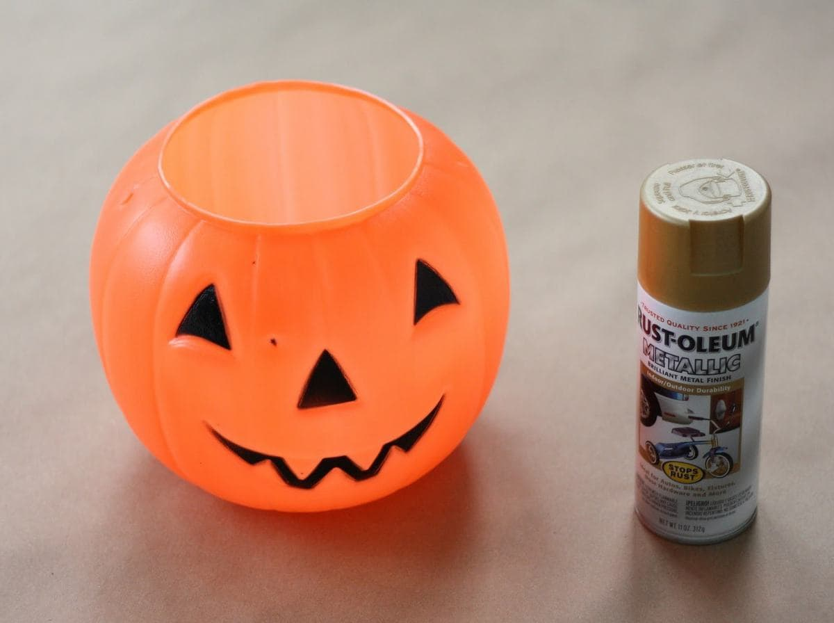 pumpkin bucket with can of spray paint next to it