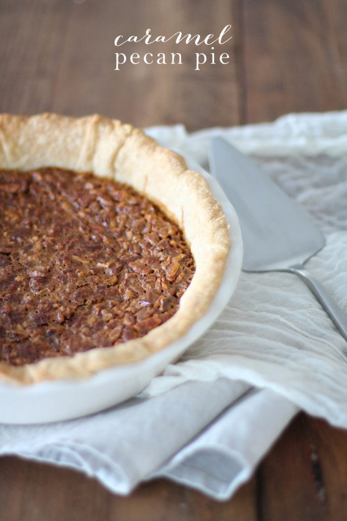 best caramel pecan pie in white pie dish with white towel and pie serving utensil with text overlay