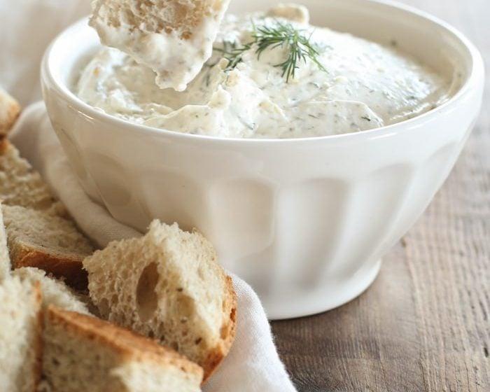 Bread being dipped in veggie dip recipe