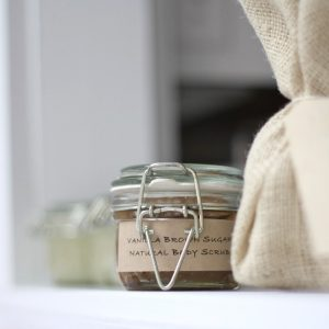 brown sugar scrub in a hinged lid jar