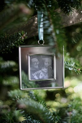 A family portrait ornament hanging from a tree.