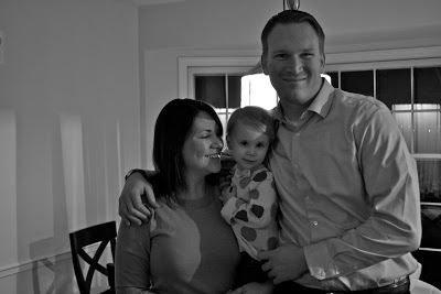 Julie and her husband holding Adalyn on her second birthday.