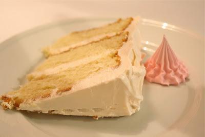A slice of vanilla birthday cake.