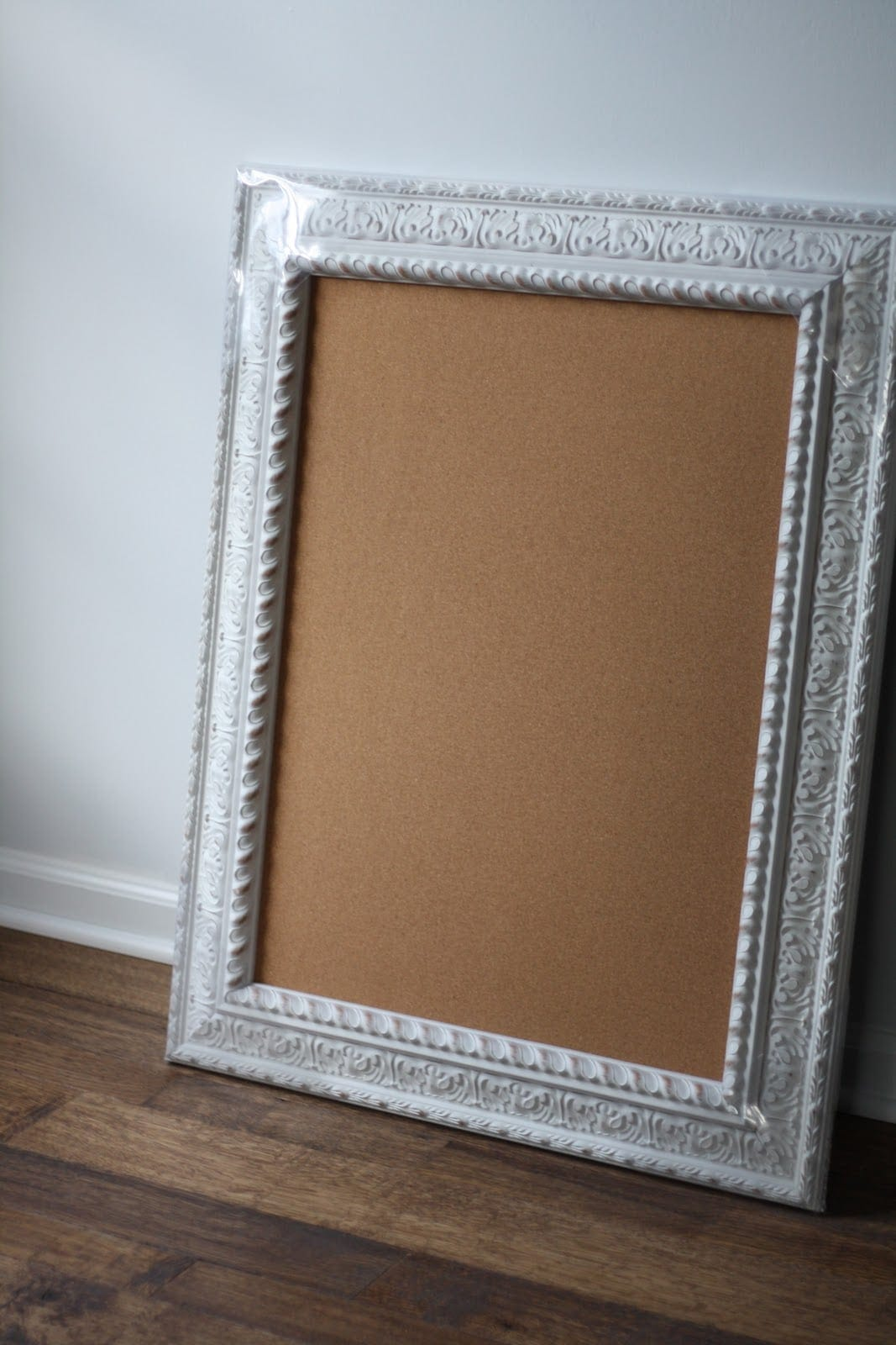 large cork board with white frame