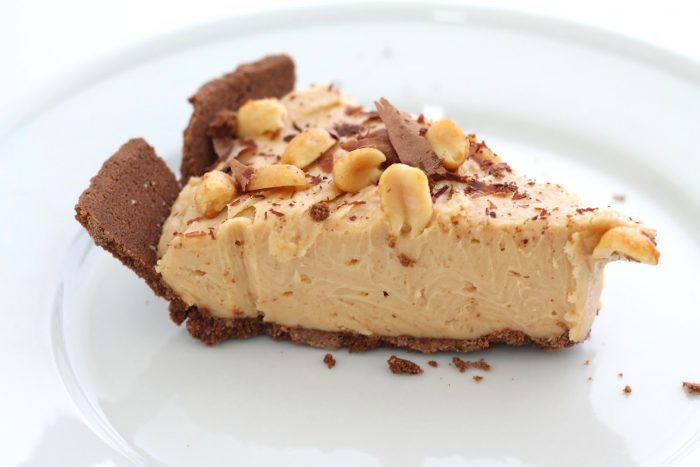 slice of easy no bake peanut butter cheesecake on white plate