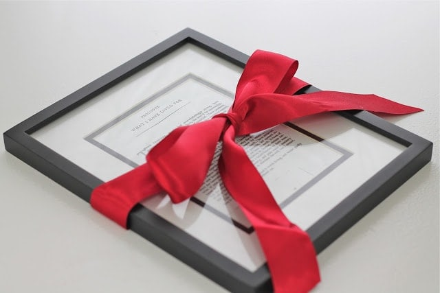 A book\'s prologue framed and wrapped in red ribbon.