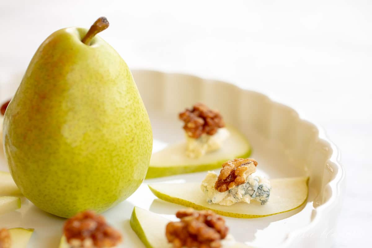 pear in center of platter with pear wedges surrounding it