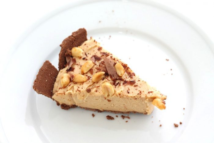 slice of peanut butter cheesecake recipe on white plate