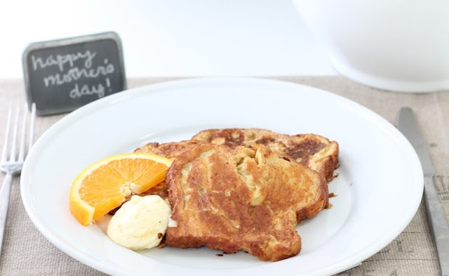 Apple Fritter French Toast served in. a white plate with butter