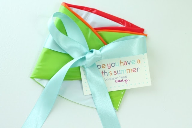 A beach ball wrapped in ribbon with a note.