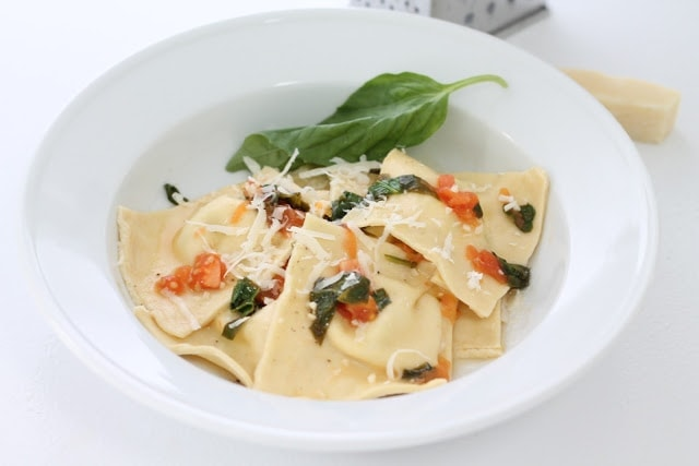 goat cheese ravioli in white pasta dish
