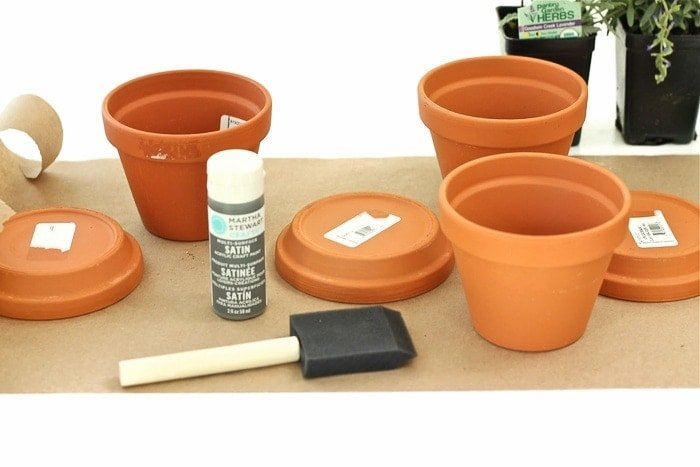 craft paint and brush with terracotta pots
