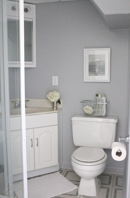 A white bathroom with gray walls