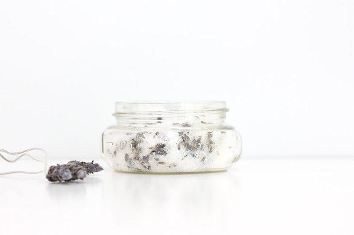 Pinecones next to a glass jar.
