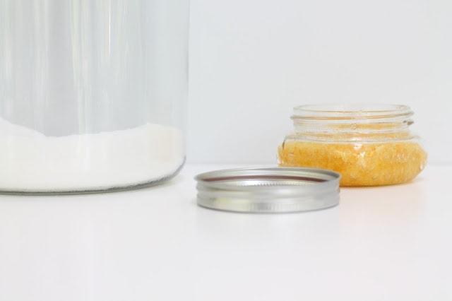 exfoliating body scrub in jar with lid