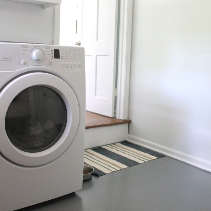 gray painted concrete floor in laundry room