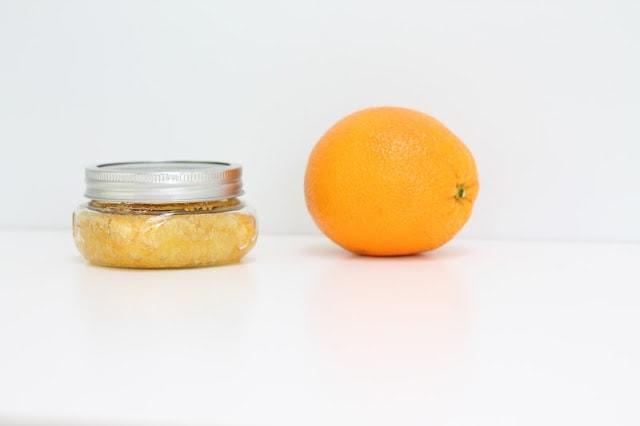 citrus sugar scrub next to an orange