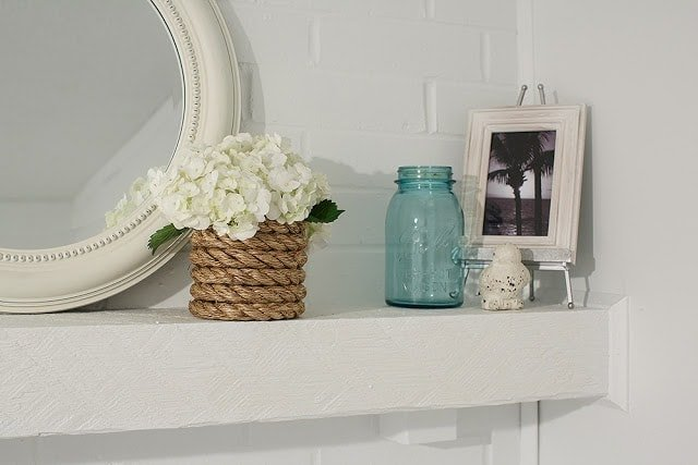 Flowers and pictures on a shelf