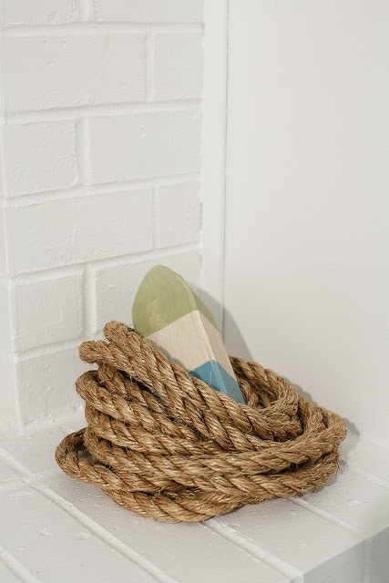 Rope and a striped bouy in a white basement guest room