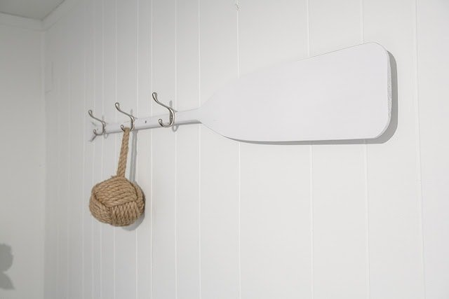 a coat hook on a paddle