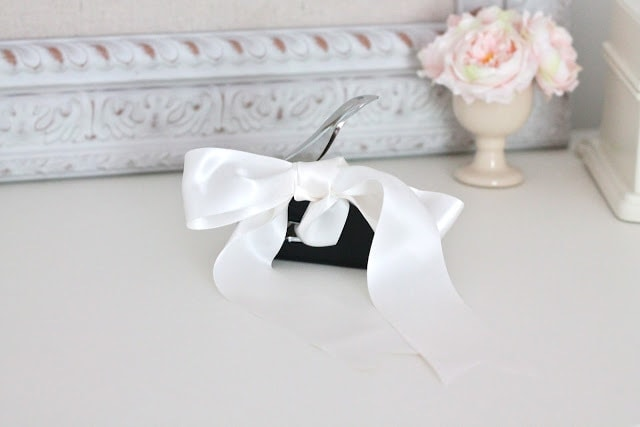 A white bow on a table