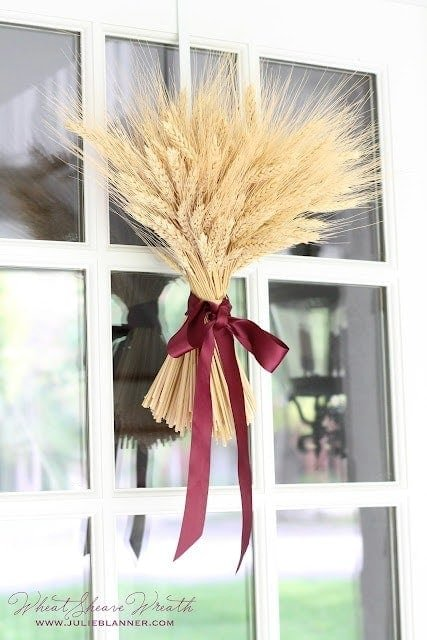 wheat sheaf fall wreath with ribbon hanging on door