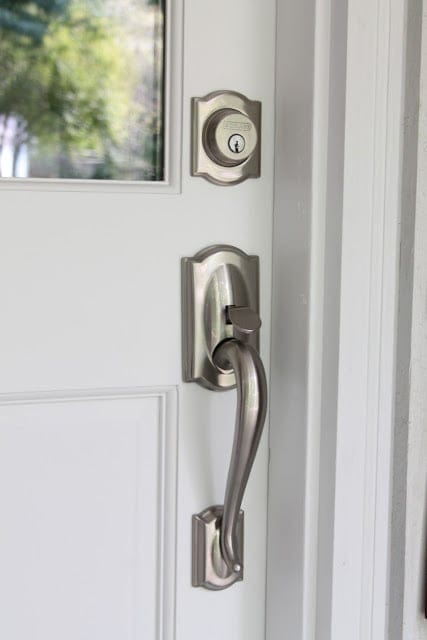 silver hardware on a white door