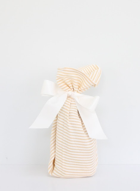A wrapped gift with a white ribbon.